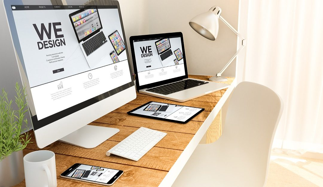 Website Design Digital generated devices over a wooden table with design responsive concept. All screen graphics are made up. 3d rendering